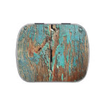 Old peeling blue paint on wooden boards candy tin