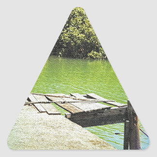 Old pier on a tranquil river triangle sticker