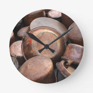 old pots and pans in the kitchen round clock