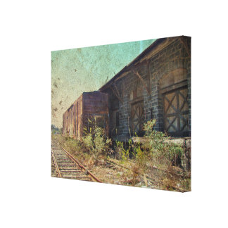 Old Rail Car and Train Station Stretched Canvas Print