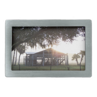 Old ranch building under trees with man statue belt buckle