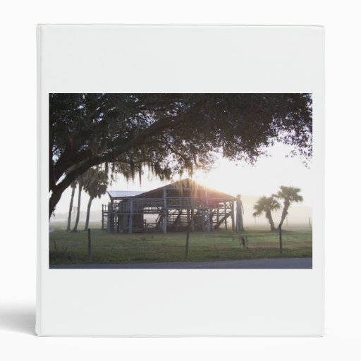 Old ranch building under trees with man statue vinyl binders