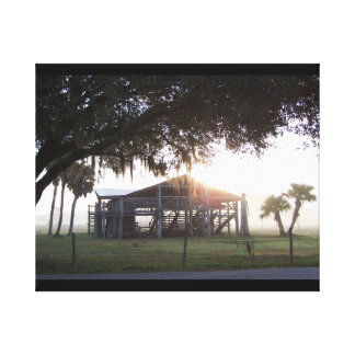Old ranch building under trees with man statue gallery wrap canvas