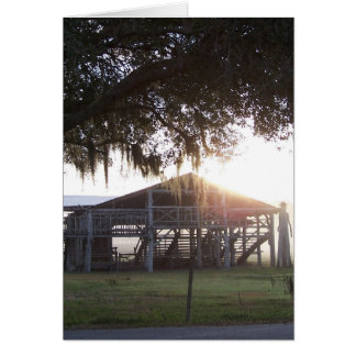 Old ranch building under trees with man statue greeting card