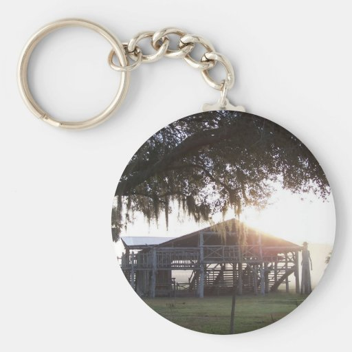 Old ranch building under trees with man statue basic round button keychain