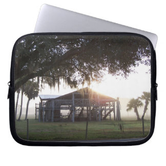 Old ranch building under trees with man statue laptop sleeve