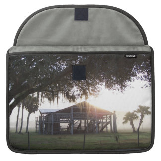 Old ranch building under trees with man statue MacBook pro sleeve