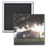 Old ranch building under trees with man statue refrigerator magnet