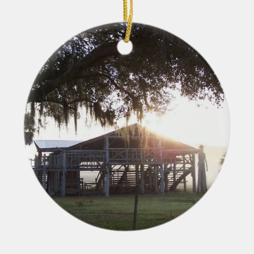 Old ranch building under trees with man statue christmas tree ornament
