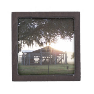 Old ranch building under trees with man statue premium keepsake box