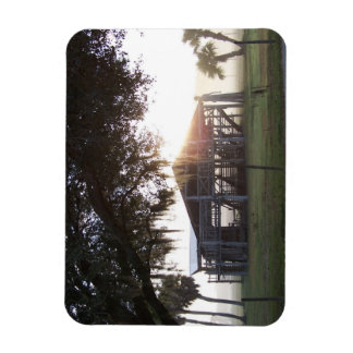 Old ranch building under trees with man statue rectangle magnet
