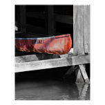 Old Red Canoe in a Wooden Boat House Poster