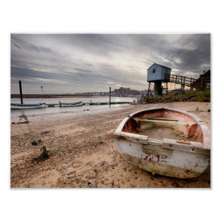 Old red rowing boat on the beach with tower poster