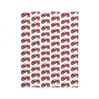 Old red tractor drawing fleece blanket