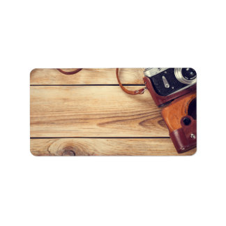 Old Retro Camera On Wooden Table Background Label
