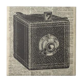 Old Retro Cube Camera Stencil Over Old Book Page Ceramic Tile