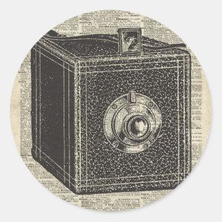 Old Retro Cube Camera Stencil Over Old Book Page Classic Round Sticker