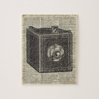 Old Retro Cube Camera Stencil Over Old Book Page Jigsaw Puzzle