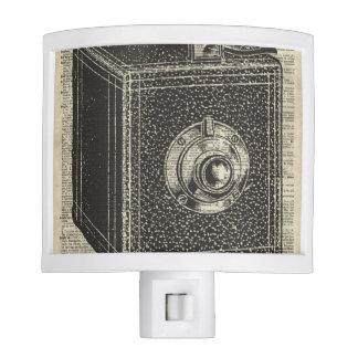 Old Retro Cube Camera Stencil Over Old Book Page Night Light