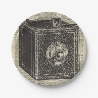 Old Retro Cube Camera Stencil Over Old Book Page Paper Plate