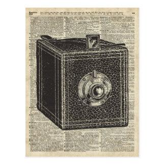 Old Retro Cube Camera Stencil Over Old Book Page Postcard