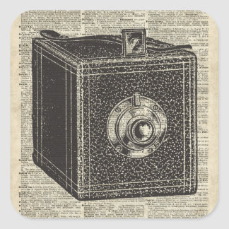 Old Retro Cube Camera Stencil Over Old Book Page Square Sticker