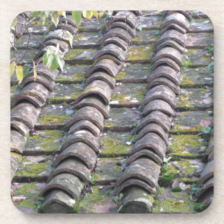 Old roof tiles on the roof of an old house coaster
