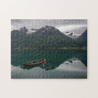 Old rowboat with mountain reflection puzzle