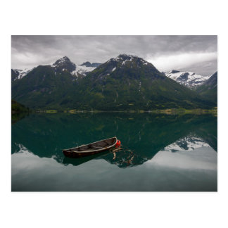 Old rowboat with mountains postcard