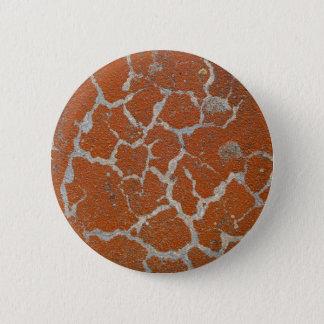 Old russet color on concrete button