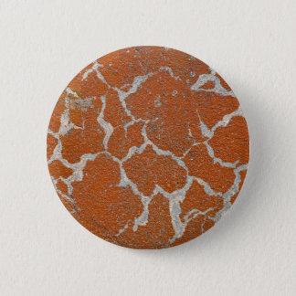 Old russet color on concrete pinback button