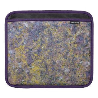 Old rusted metal surface with small yellow mold iPad sleeves