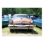 old rusty classic car front at a car show business card