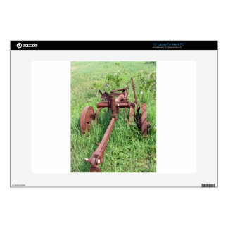 Old rusty plow skins for laptops