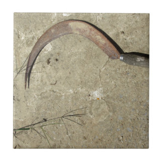 Old rusty sickle tile