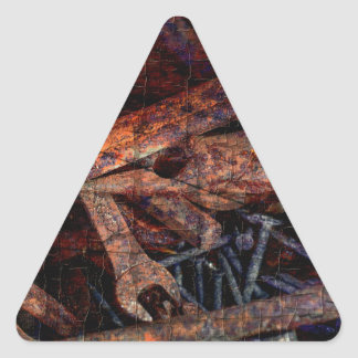 Old rusty tools. triangle sticker