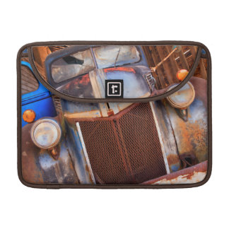 Old rusty truck on a farm sleeve for MacBooks