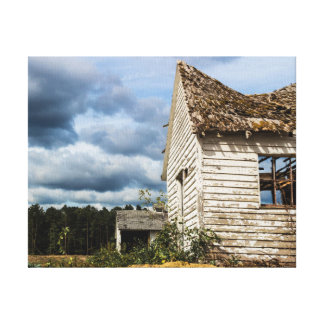 Old Shack and Storm Clouds Canvas Print