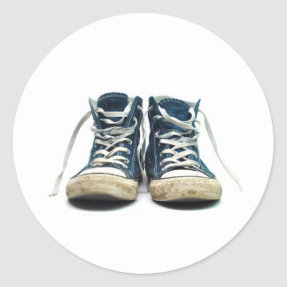 old sneakers dirty sport shoes white background classic round sticker