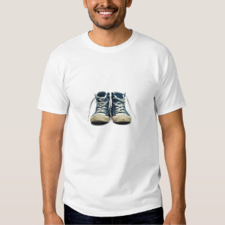 old sneakers dirty sport shoes white background tee shirt