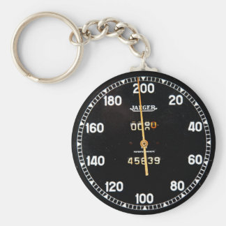 Old speedometer gauge from a vintage race car basic round button keychain