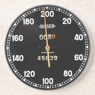 old speedometer gauge from a vintage race car drink coaster