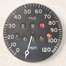 Old speedometer gauge from a vintage race car drink coaster