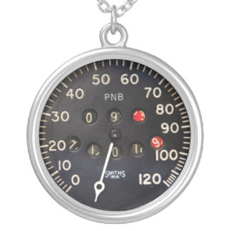 Old speedometer gauge from a vintage race car silver plated necklace