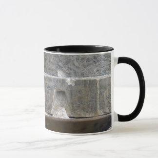 old stone grinder mug