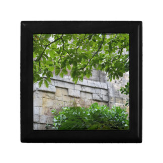 old stone wall framed in leaves trinket box