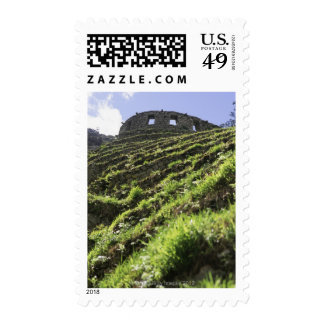 Old structure at top of steep hill postage stamps