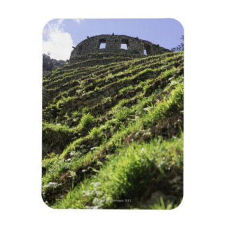 Old structure at top of steep hill rectangular photo magnet