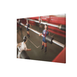 Old table football player stretched canvas prints