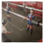 Old table football player large square tile